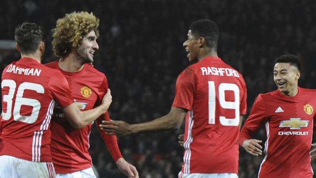 Manchester United's Marouane Fellaini, second left, celebrates.