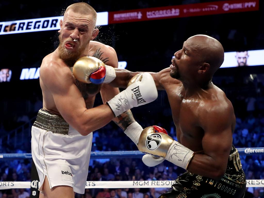 Mayweather knocked the snot out of Conor McGregor. (Photo by Christian Petersen/Getty Images)