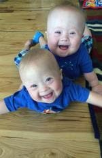 Meet Charlie and Milo - the incredibly rare Down syndrome twins who are guaranteed to make you smile. Picture: Caters News