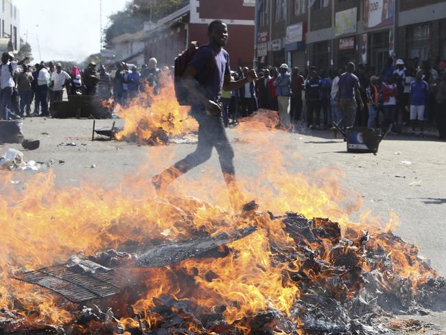 Opposition MDC party supporters protest in the streets during clashes with police. Picture: AP