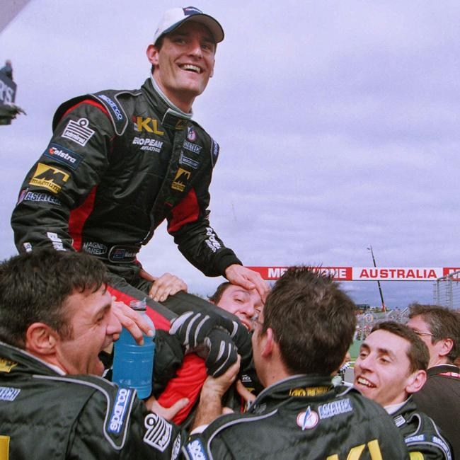 The Minardi crew hoist Webber aloft after his fifth place finish. Pic: Wayne Ludbey