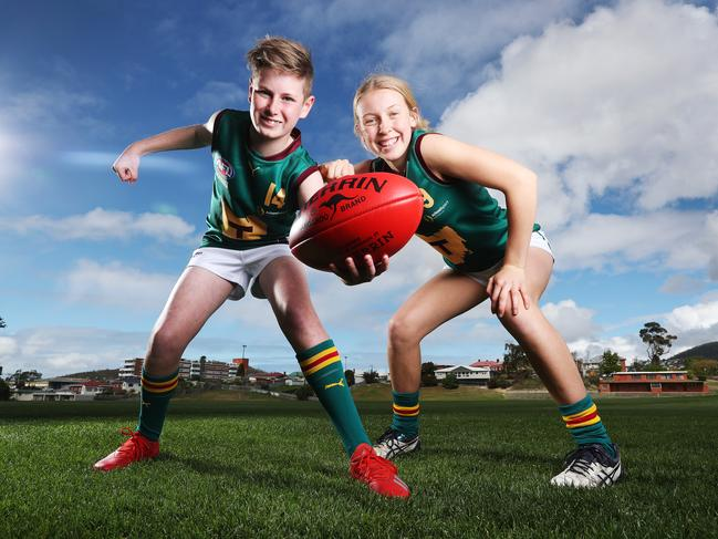 Tasmania Devils players Oliver Cunningham, 12. of New Town, and Claire Ransom, 15, of Mount Stuart, are excited that Tasmania has reached the 50,000 pledge target. Picture: ZAK SIMMONDS