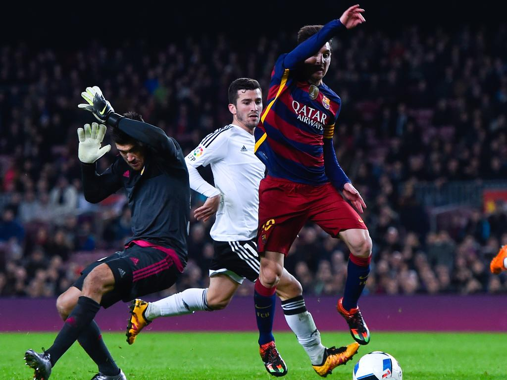 Lionel Messi goes past Maty Ryan during his time playing for Valencia