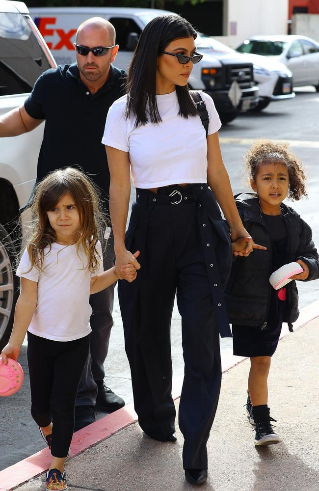 Kourtney Kardashian, centre, with her daughter Penelope Disick (left) and niece North West. Picture: Splash