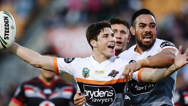 Mitchell Moses celebrates after scoring a try.