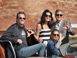 George Clooney, right, his fiancee Amal Alamuddin, Cindy Crawford and her husband Rande Gerber, left, arrive in Venice, Italy, Friday, September 26th 2014. Picture: AP