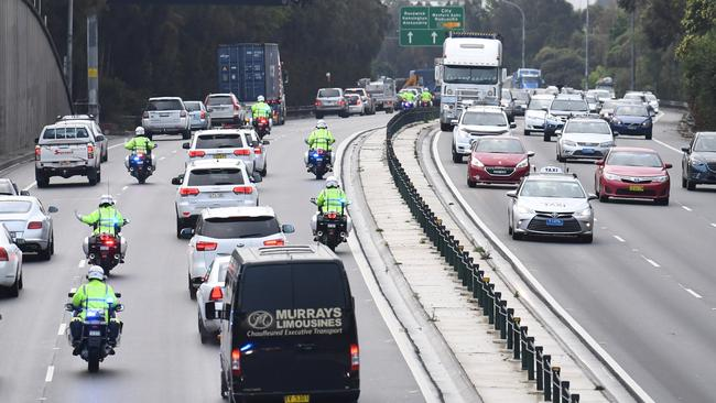 The motorcade carrying the Duke and Duchess of Sussex in Sydney. Picture: AAP/Dean Lewins