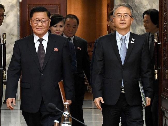 Hyon Song-wol walks into talks on Monday behind North Korea's chief delegate Kwon Hyok-bong (L) and South Korea's chief delegate Lee Woo-sung (R) during talks at the border village of Panmunjom. Picture: South Korean Unification Ministry