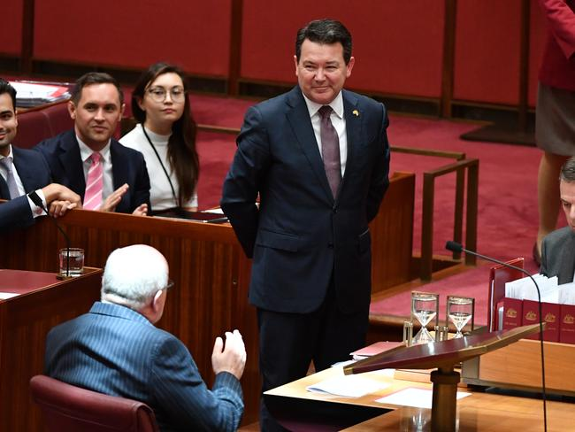 Liberal Senator Dean Smith smiles after the vote for the Bill. Picture: AAP Image/Mick Tsikas
