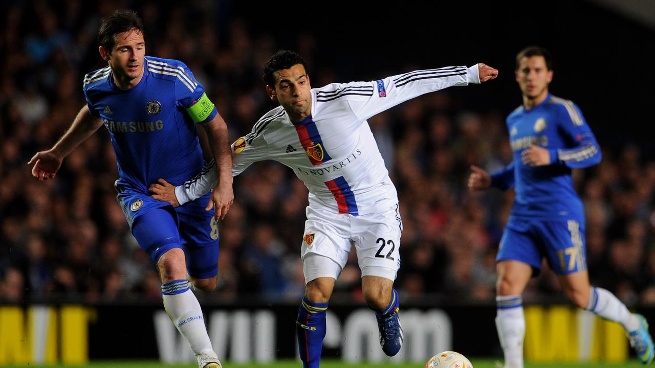 Salah holds off Lampard during a Europa League game in 2013