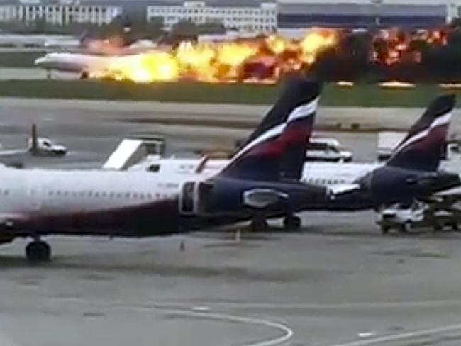 The SSJ-100 aircraft on fire during an emergency landing in Sheremetyevo airport. Picture: @artempetrovich via AP