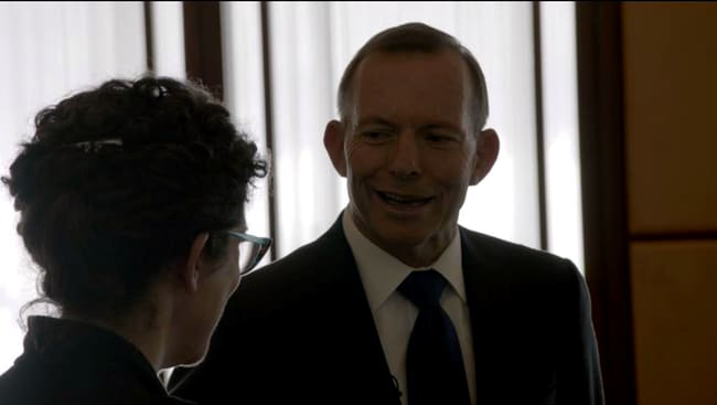 Abbott grins as he shares his story with Crabb. Picture: ABC
