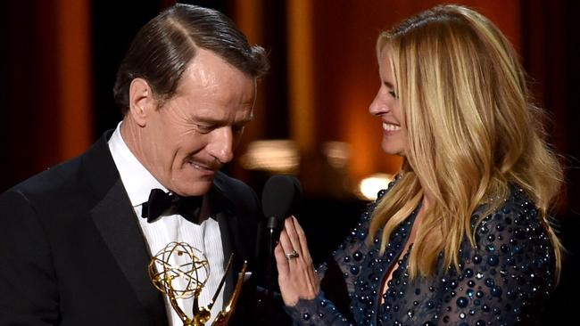 Memorable presentation ... Julia Roberts presents actor Bryan Cranston with Emmy for Outstanding Lead Actor in a Drama Series. Picture: Getty