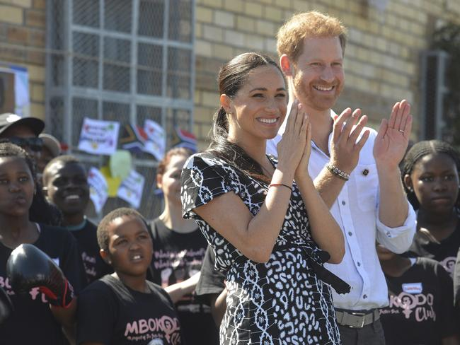 The couple received glowing coverage of their South Africa trip, but it was overshadowed by another bombshell statement from Prince Harry. Picture: Courtney Africa/Pool via AP.