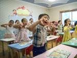 Children gesture and shout at the instruction of a teacher at Gyongsang Kindergarten on August 23, 2018 in Pyongyang. Picture: Carl Court/Getty Images