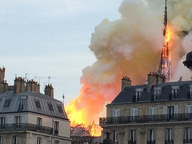 Smoke and flames rising during a fire at the landmark Notre-Dame Cathedral in central Paris. Picture: AFP