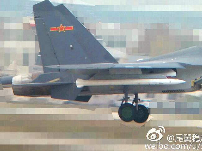 This picture from China's state-run social media site Weibo last year is believed to show a J-16 fighter carrying a prototype hypervelocity missile.