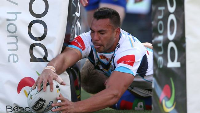 Ryan James of the Titans scores a try.