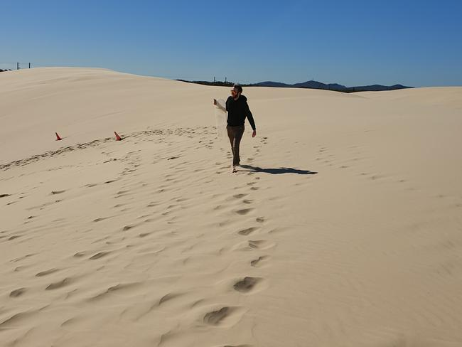 Tackling the sand dunes in the very warm winter sun, not far from Anna Bay.