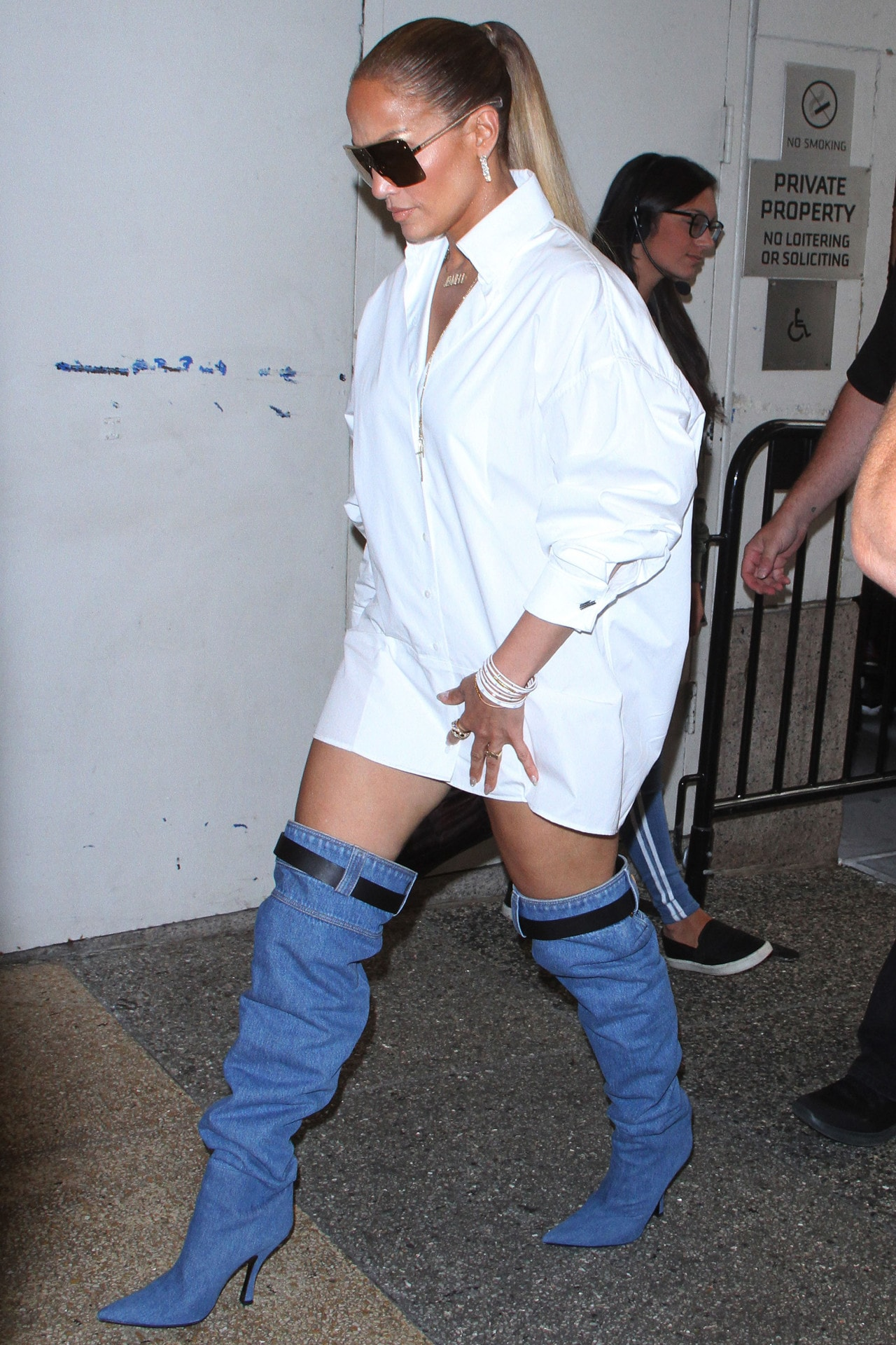 Jennifer Lopez out in New York wearing Versace's jean boots. Image credit: Mega