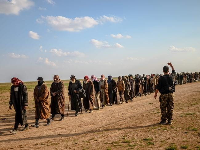Men suspected of being Islamic State fighters wait to be searched by members of the Kurdish-led Syrian Democratic Forces. Picture: AFP