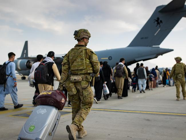 Australian citizens and visa holders board a flight from Kabul.  The Morrison government has pledged to provide 3,000 places for Afghan refugees, but Christian church leaders want 20,000. Image: Supplied