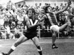 Rivals Barrie Robran and Neville Roberts during a North vs West Torrens match at Thebarton Oval, 1974.
