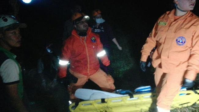 Rescuers at the site of the wreckage.