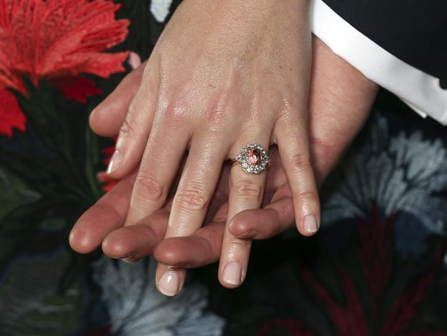 Princess Eugenie's ring contains a padparadscha sapphire surrounded by diamonds. Picture: Jonathan Brady via AP