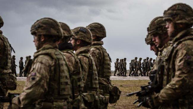 US and Polish troops take part in the official welcoming ceremony for NATO troops — part of The Enhanced Forward Presence, in Orzysz, Poland in April last year. Picture: Wojtek Radwanski