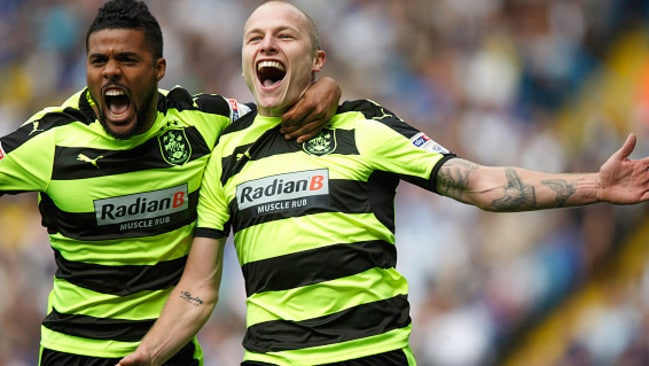 Aaron Mooy celebrates with Elias Kachunga after scoring for Huddersfield Town.