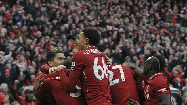 Liverpool players celebrate after Tottenham's Toby Alderweireld scores an own goal