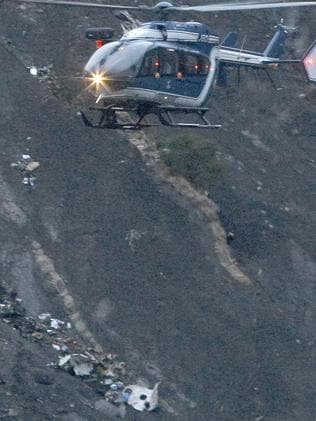 Steep ... debris of the Germanwings passenger jet is scattered on the mountain side. Picture: AP