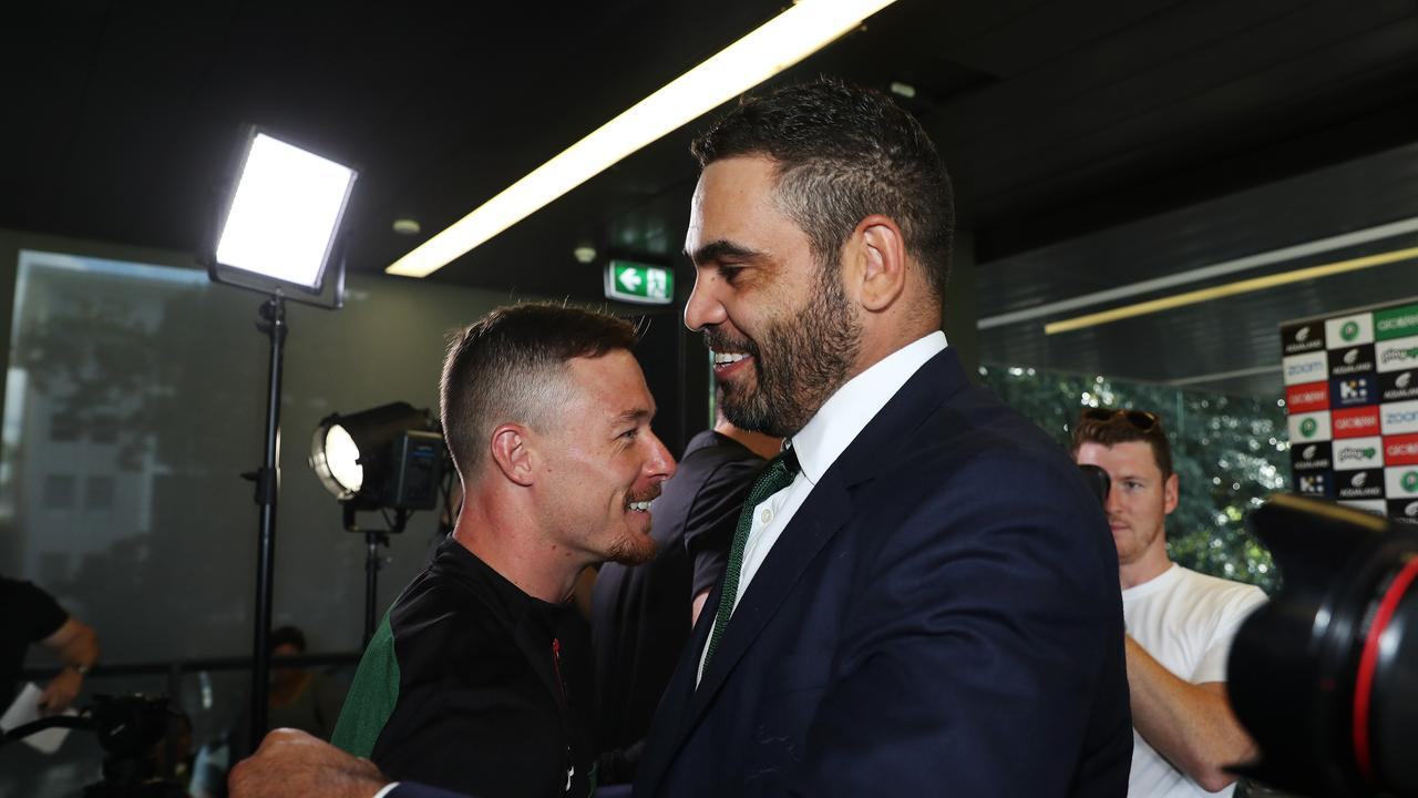Greg Inglis embraces teammate Damien Cook at his retirement press conferece.