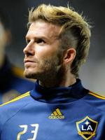 <p>David Beckham of the Los Angeles Galaxy with a new haircut against Houston Dynamo during the MLS Western Conference Championship soccer match at The Home Depot Center on November 13, 2009 in Carson, California.</p>