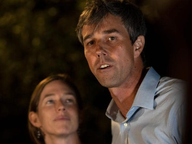 Beto O'Rourke and his wife, Amy Hoover Sanders (L). Picture: AFP