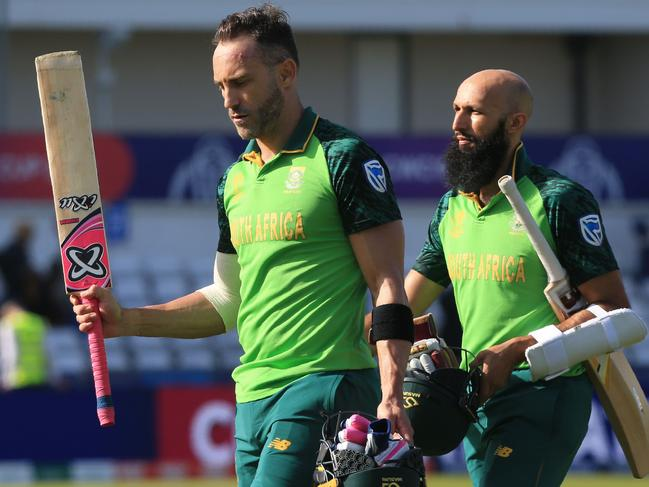 South Africa's captain Faf du Plessis Hashim Amla leave the field at close of play.
