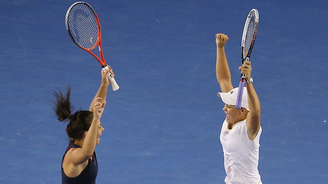 Casey Dellacqua and Ashleigh Barty of Australia celebrate after winning their doubles Semifinal match against Varvara Lepchenko of the United States and Saisai Zheng of China during day ten of the 2013 Australian Open.