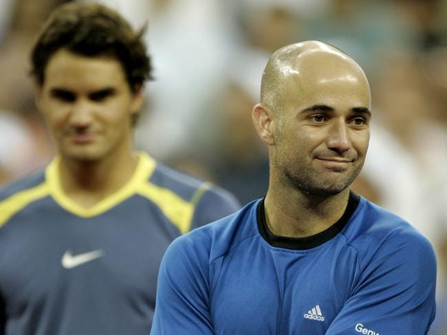 Federer and Agassi during the presentation.