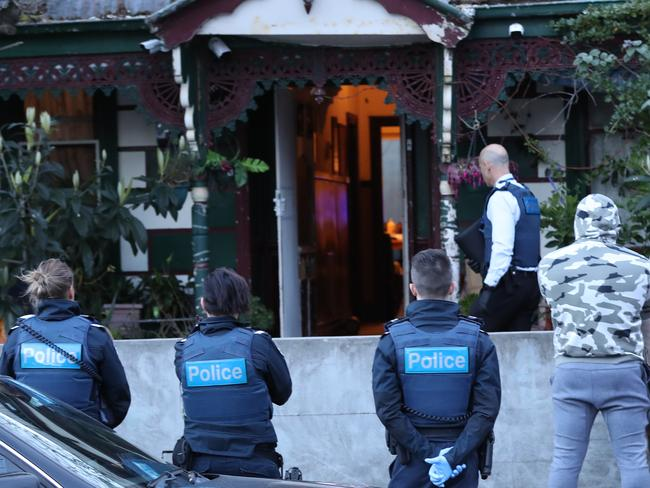 Police raid a house in Hope St, Brunswick. One man has been arrested. Picture: David Crosling