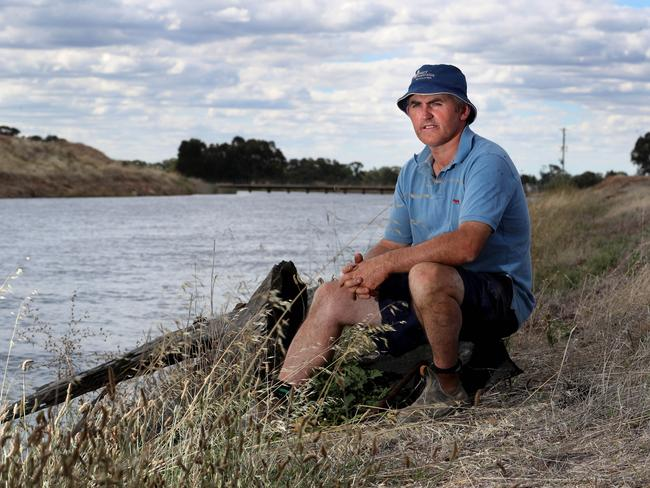 Australia system of water trading doesn't always keep everyone happy though. Dairy Farmer Tony McCarthy next to an irrigation channel on his property at Dhurringle in Victoria. He has concerns about losing water from the system to be allocated further down stream in South Australia. Picture: David Geraghty, The Australian.