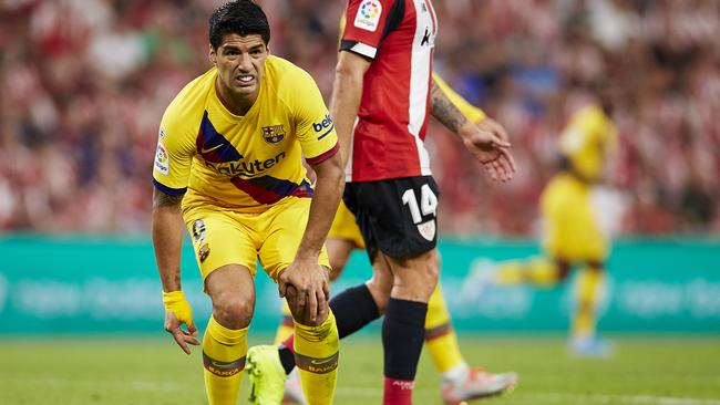 An injury to Luis Suarez compounded Barca's woes. Picture: AP