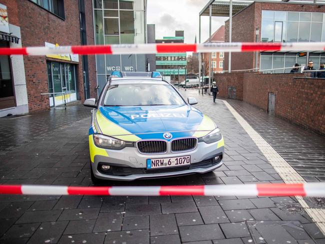 A police car in a cordoned off area at the site where a man injured four people in Bottrop, Germany. Picture: AFP