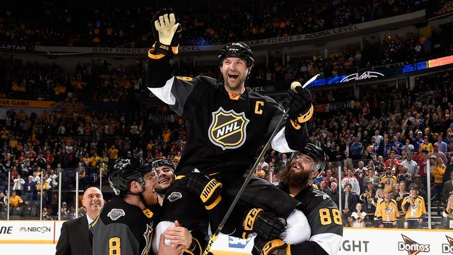 John Scott is held up by teammates in the 2016 NHL All-Star Final Game.