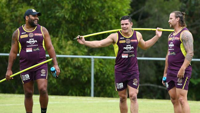 Sam Thaiday, James Roberts and Korbin Sims at training.