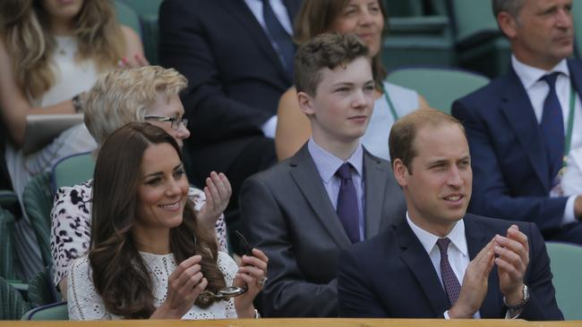 Britain's Prince William, right, and Kate, Duchess of Cambridge, left, applaud in the Royal Box on centre court during the women's singles quarterfinal match between Simona Halep of Romania and Sabine Lisicki of Germany.