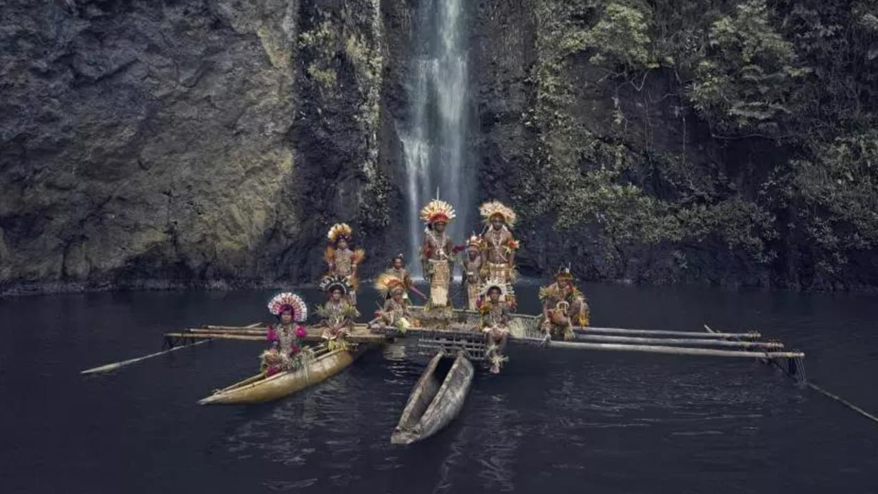 The Tufi tribe in New Guinea on their fishing boat. Picture: Jimmy Nelson