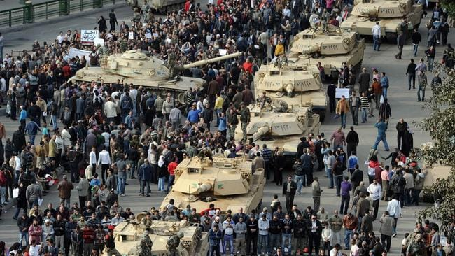 A column of Abrams tanks line the street as Egyptian demonstrators gather in Tahrir Square in Cairo. Picture: AFP Photo/Miguel Medina