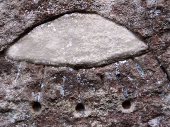 Aliens! Really? This shape scratched out of the sandstone face of a Gosford rock formation is being interpreted as representing an ancient flying saucer. Picture: History Channel