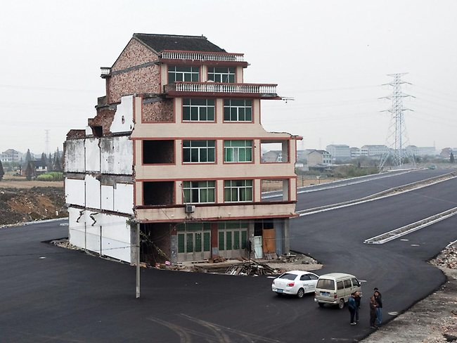 Refuseniks: elderly Chinese couple refuse to sign agreement allowing their house to be demolished by authorities. (AP Photo)